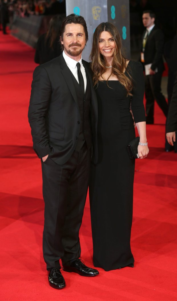 Actor Christian Bale and his wife Sibi Blazic pose for photographers on the red carpet at the EE British Academy Film Awards held at the Royal Opera House on Sunday Feb. 16, 2014, in London. (Photo by Joel Ryan/Invision/AP)