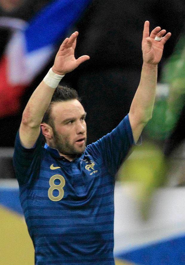 France's Mathieu Valbuena celebrates after scoring against Germany during their international friendly soccer match at the Stade de France stadium in Saint-Denis, near Paris, February 6, 2013.  REUTERS/Gonzalo Fuentes (FRANCE  - Tags: SPORT SOCCER)   SLOWA KLUCZOWE: :rel:d:bm:LR1E9261LXQIP