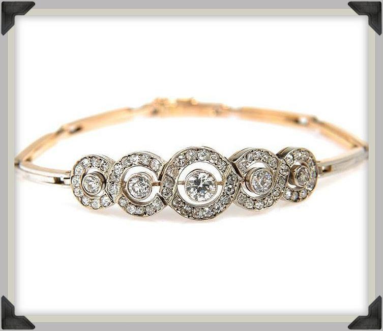 Bransoletka (Petersburg, pocz. XX w.)  złoto pr. '56', srebro, 5 diamentów ł. ~ 1,40 ct J-K/Si-Si2, 57 diamentów ł. ~ 1,00 ct I-J/VS-P, bransoletka wtórna - złoto pr.'3', platyna pr. 0,950, masa: 14,49 g