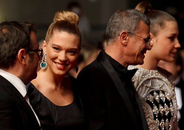 From left, producer Vincent Maraval, actress Lea Seydoux, director Abdellatif Kechiche and actress Adele Exarchopoulos pose for photographers prior to the screening of La Vie D'Adele at the 66th international film festival, in Cannes, southern France, Thursday, May 23, 2013. (AP Photo/David Azia)