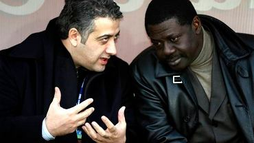 Marseille's new president Jack Kachkar, left, has a talk with Olympique de Marseille's manager Pape Diouf before the French League One soccer match against Le Mans, France Saturday, Jan. 27, 2007 in Le Mans, western France. (AP Photo/David Vincent)