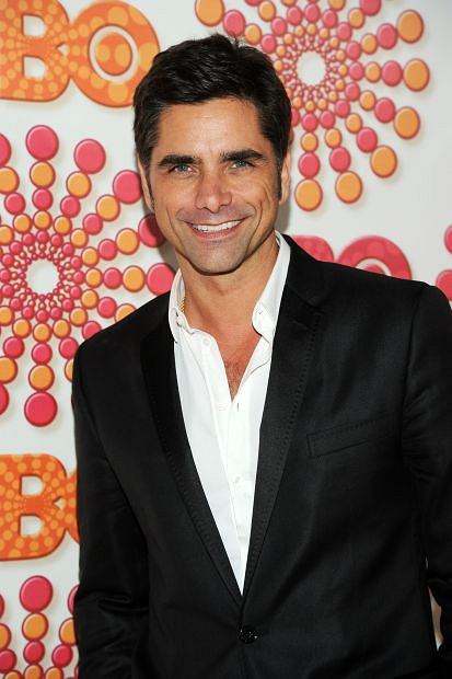 Actor John Stamos arrives at the HBO post-award reception following the 63rd Annual Primetime Emmy Awards at the Pacific Design Center in West Hollywood, Calif. on Sunday, Sept. 18, 2011. (AP Photo/Kristian Dowling)