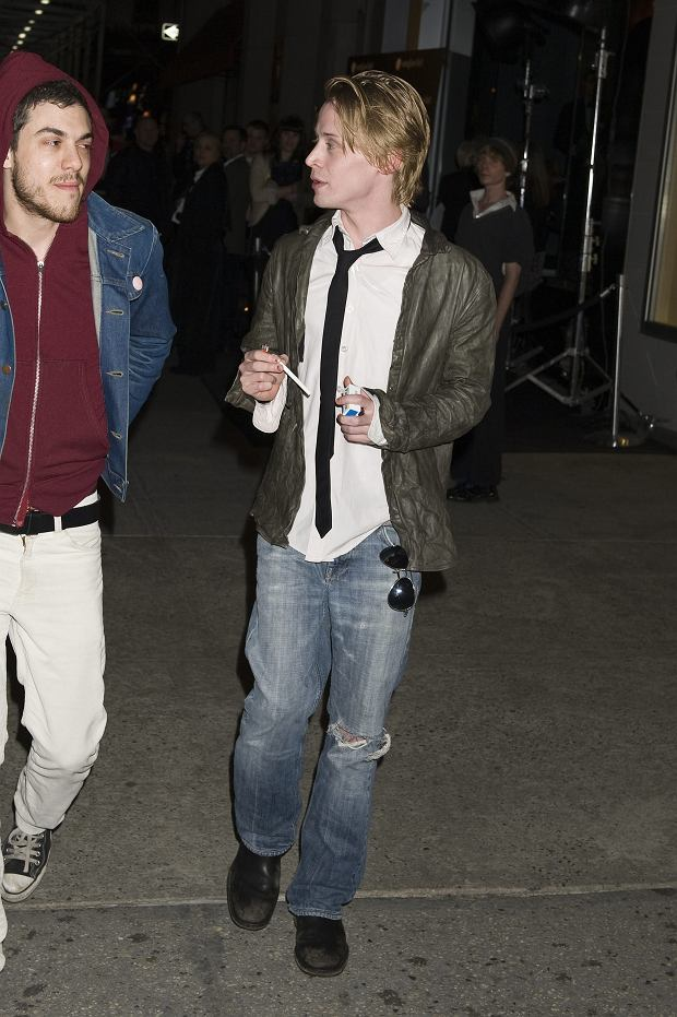 NEW YORK CITY - APRIL 28: Macaulay Culkin lights up a cigarette outside on fifth avenue after attending the Sunglass Hut store opening on April 28, 2010 in New York City, New York.  (Photos by Justin Campbell/BuzzFoto.com)    Buzz Foto LLC  http://www.buzzfoto.com/  1112 Montana Ave Suite 80  Santa Monica CA 90403  1 310 441 4464  1 310 980 8822  1 310 691 3888 *** Local Caption *** Macaulay Culkin
