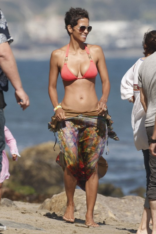 Halle Berry celebrated her birthday with her daughter Nahla and a group of friends on the beach in Malibu, California. At one point Halle was carried to the water and thrown into by a friend.  Pictured: Halle Berry