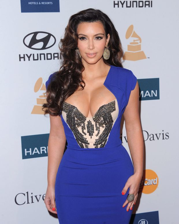 Kim Kardashian   attends the Annual Clive Davis & The Recording Company Pre-Grammy Gala held at The Beverly Hilton in Beverly Hills, California, USA,   February 11th 2011.  grammys party half length dress hair beauty make-up cleavage boobs blue  studded beaded bustier cream beige earrings                                        CAP/RKE/DVS  ?DVS/RockinExposures/Capital Pictures