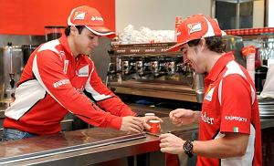 Ferrari drivers Felipe Massa of Brazil (L) and Fernando Alonso of Spain (R) learn to make coffee during a media event ahead of Formula One's Australian Grand Prix in Melbourne on March 15, 2012.  IMAGE RESTRICTED TO EDITORIAL USE  AFP PHOTO/William WEST (Photo credit should read WILLIAM WEST/AFP/Getty Images)