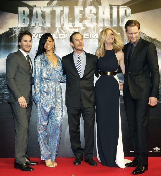 """American film director Peter Berg, center, and the cast of his film """"Battleship,"""" from left, Taylor Kitsch, Rihanna, Brooklyn Decker, and Alexander Skarsgard, pose for photographers during the world premiere of their movie in Tokyo Tuesday, April 3, 2012. (AP Photo/Shizuo Kambayashi)"""