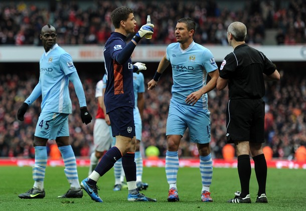 LONDON, ENGLAND - APRIL 08:  Wojciech Szczesny of Arsenal looks at a bottle of beer that was thrown onto the pitch  during the Barclays Premier League match between Arsenal and Manchester City at Emirates Stadium on April 8, 2012 in London, England.  (Photo by Michael Regan/Getty Images)