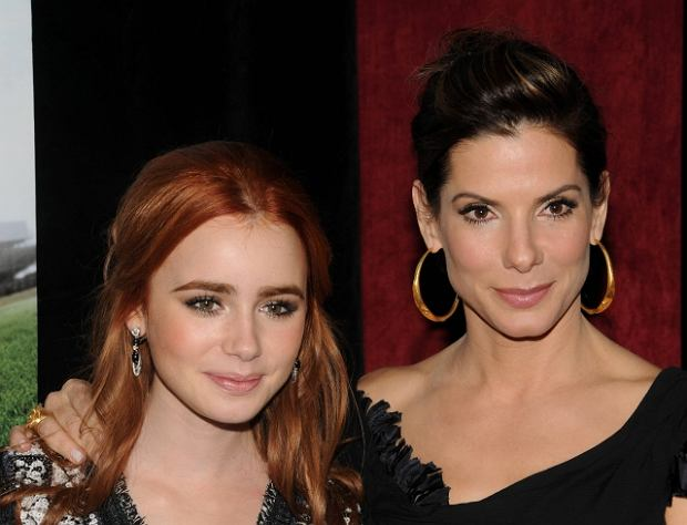 "Actors Lily Collins, left, and Sandra Bullock attend the Warner Bros. Pictures premiere of ""The Blind Side,"" in New York, Tuesday, Nov. 17, 2009. (AP Photo/Peter Kramer)"