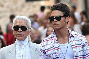 Słynny projektant Chanel Karl Lagerfeld pojawił się we francuskim Saint Tropez wraz ze swoim partnerem modelem Baptistem Giabiconi.