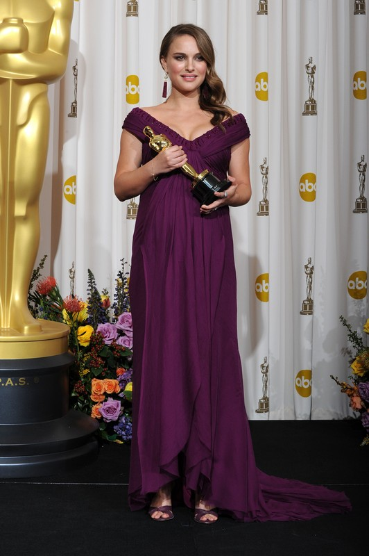 Actress Natalie Portman holds the award for Best Actress in a Motion Picture for her role in
