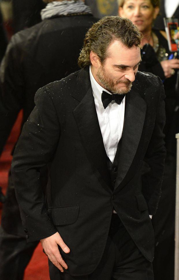 Joaquin Phoenix arrives for the British Academy of Film and Arts (BAFTA) awards ceremony at the Royal Opera House in London February 10, 2013.     REUTERS/Paul Hackett (BRITAIN - Tags: ENTERTAINMENT)