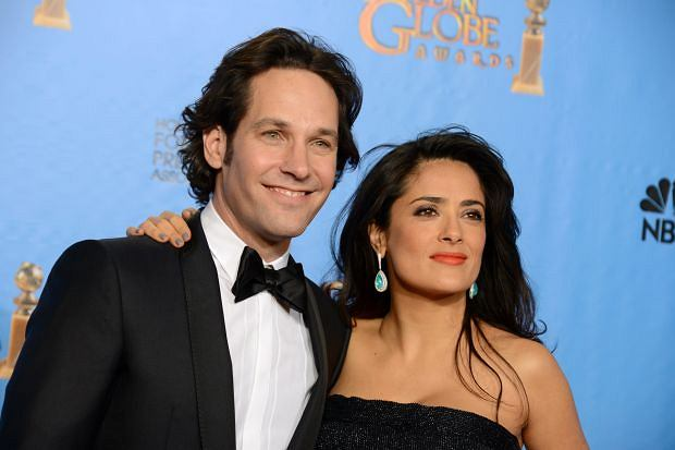 Presenters Paul Rudd, left, and Salma Hayek pose backstage at the 70th Annual Golden Globe Awards at the Beverly Hilton Hotel on Sunday Jan. 13, 2013, in Beverly Hills, Calif. (Photo by Jordan Strauss/Invision/AP)