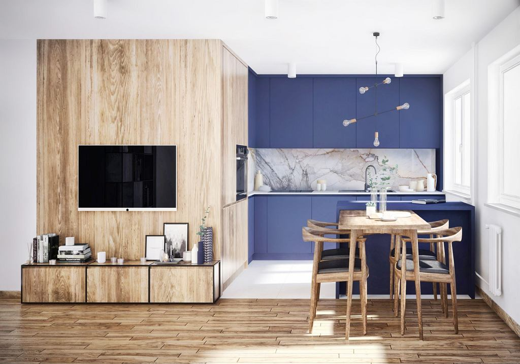 Zaproponowany w aneksie kuchennym kolor Navy Peony z palety PANTON 2017 sprawia, iż przestrzeń uwodzi atrakcyjnym wyglądem. Zamiast klasycznych płytek nad blatem pojawia się marmur.