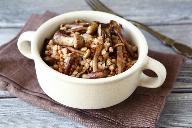 333643955 - buckwheat with mushrooms in a bowl, food