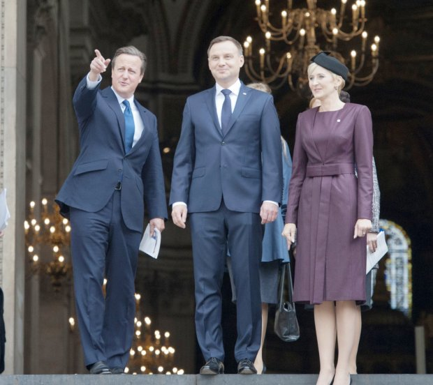 Prime Minister David Cameron together with President Andrej Duda of Poland and his wife Agata leaves after a service at St Pauls Cathedral in London to mark the 75th anniversary of the Battle of Britain.