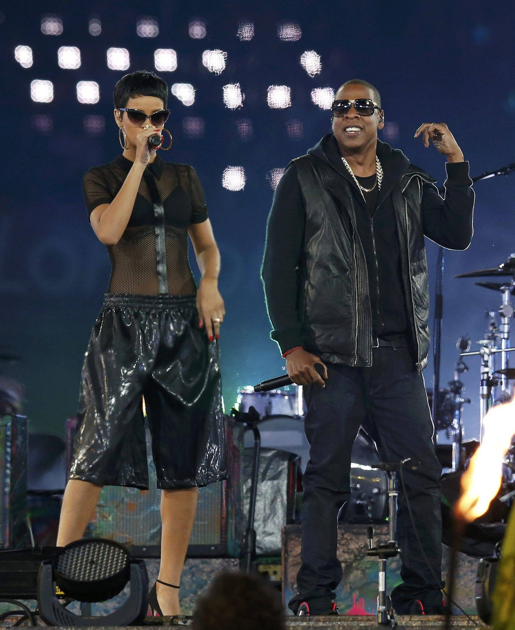 Singer Rihanna  and rapper Jay Z (R)  perform in the Olympic Stadium during the closing ceremony of the London 2012 Paralympic Games September 9, 2012.            REUTERS/Suzanne Plunkett (BRITAIN  - Tags: OLYMPICS SPORT ENTERTAINMENT)