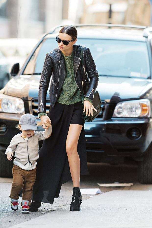 Miranda Kerr shows off her enviable legs while out with baby Flynn in NYC.  Pictured: Miranda Kerr and Flynn Bloom