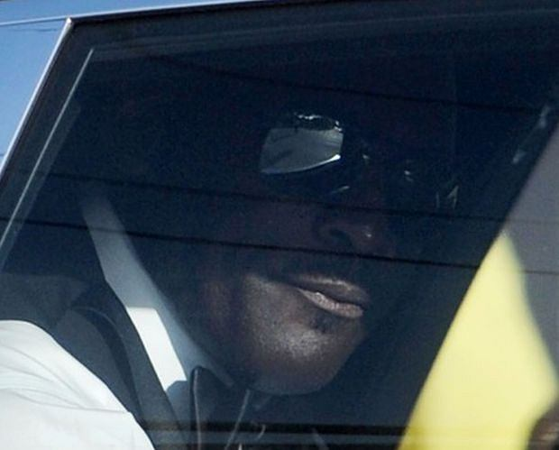 A sharply-dressed Michael Jordan was spotted making a swift exit from his high-security Florida wedding in a white Rolls Royce. The NBA legend chose not to show off his bride Yvette Prieto to awaiting fans and press, instead enlisting dozens of security guards to conceal the happy couple with white umbrellas. As a Jordan-lookalike rolled up outside the church in a black SUV and waved to screaming fans, the basketball superstar himself was whisked away from the the chapel after the April 27 nuptials. VIP guests included his ex-Chicago Bulls team mate Scottie Pippen and his wife Larsa, former pro-basketballer Patrick Ewing and golfing ace Tiger Woods had been spotted at the exclusive event, which took place at Bethesda-By-The-Sea Church, in Palm Beach, as well as Jordan's mother Dolores Jordan. The 2000-plus guests later celebrated at a lavish after party inside the Bear's Club gated community in nearby Jupiter, where Jordan has a stunning mansion.  Pictured: Michael Jordan