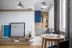 Aranżacja mieszkania z niebieskim kolorem przewodnim. Nowoczesne rozwiązania na 45 m kw.