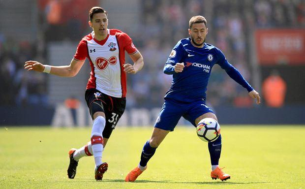 8f03687d9 Southampton's Jan Bednarek, left, and Chelsea's Eden Hazard battle for the  ball during their