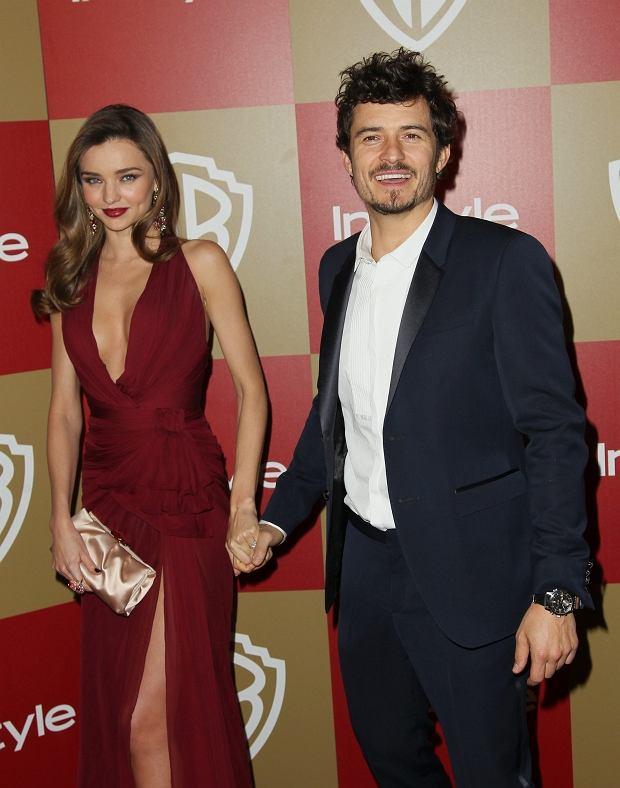 Miranda Kerr, left, and Orlando Bloom arrive at the InStyle and Warner Bros. Golden Globe After Party at the Beverly Hilton Hotel on Sunday Jan. 13, 2013, in Beverly Hills, Calif. (Photo by Matt Sayles/Invision/AP)