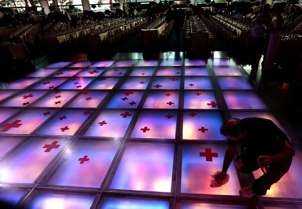A worker cleans the dance floor at the Monte Carlo Sporting Club where the Red Cross Gala yakes place in Monaco August 2, 2013. The Red Cross ball is a traditional and annual charity event in the Principality of Monaco. REUTERS/Eric Gaillard (MONACO - Tags: SOCIETY)