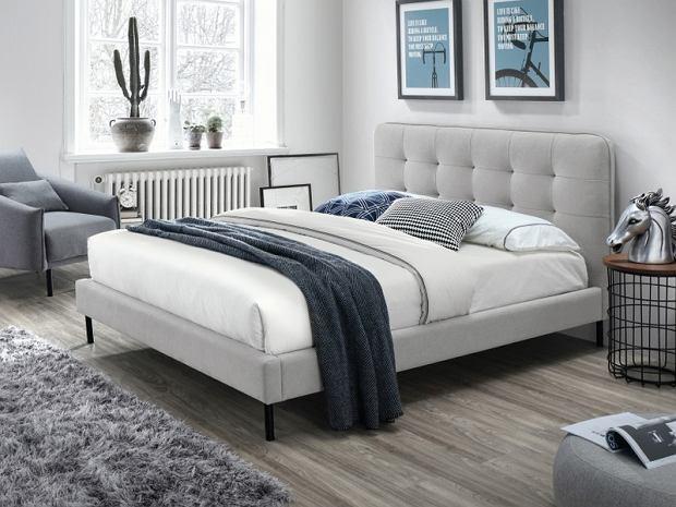 Łóżko z tapicerowanym wezgłowiem - nowoczesne i wygodne modele