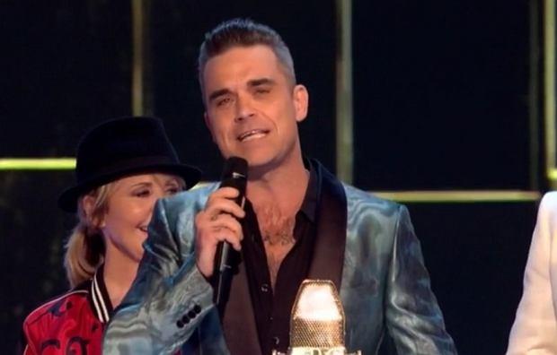 Robbie Williams odebrał nagrodę w imieniu nieobecnej na gali Adele