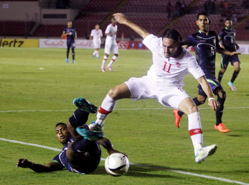 Canadas Issey Nakajima-Farran battles for the ball with Panamas Harold Cummings during a friendly soccer match in Panama City