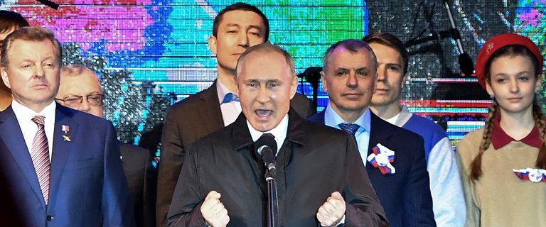Putin na obchodach aneksji Krymu.