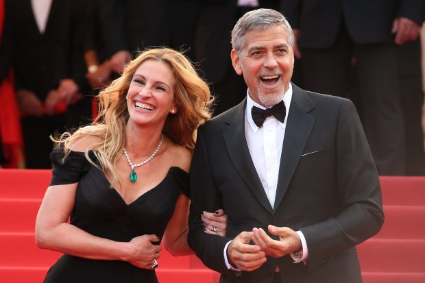 Actors George Clooney, right, and Julia Roberts pose for photographers upon arrival for the screening of the film Money Monster at the 69th international film festival, Cannes, southern France, Thursday, May 12, 2016. (AP Photo/Joel Ryan)