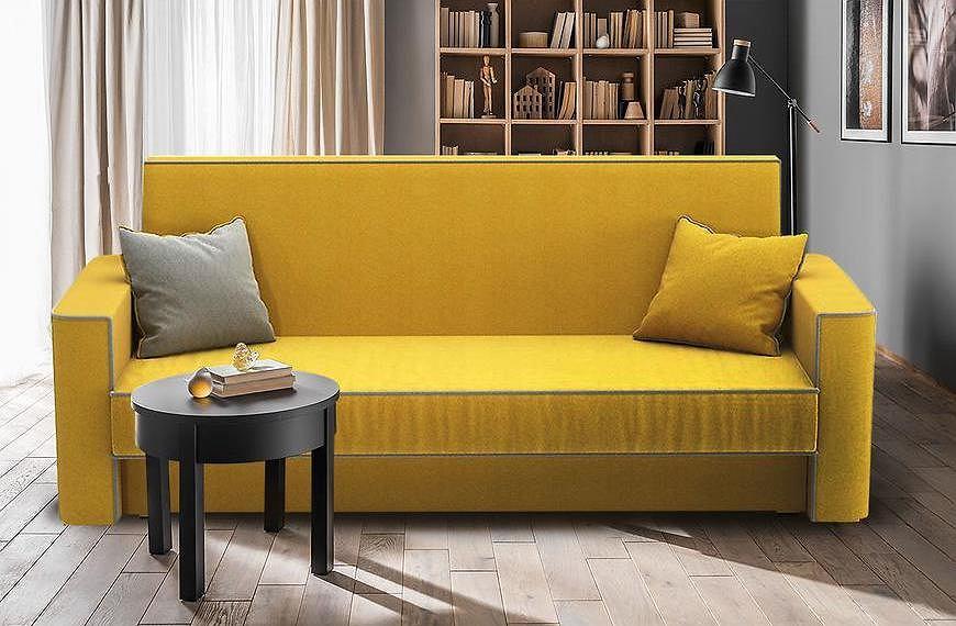 Żółta wersalka do pokoju.