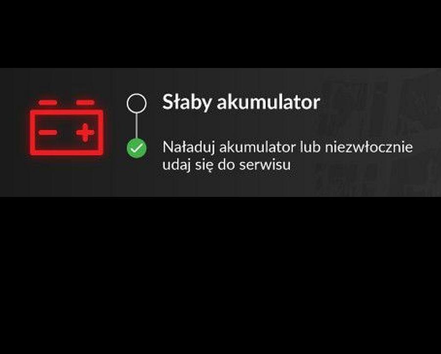 Czerwona kontrolka z akumulatorem z plusem i minusem