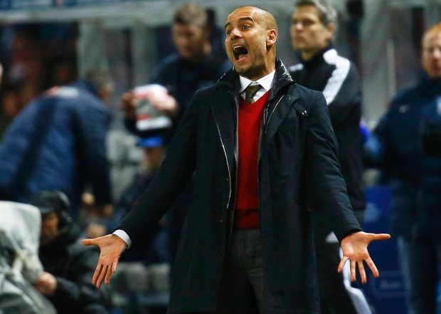 Bayern Munich's coach Pep Guardiola reacts during their German first division Bundesliga soccer match against Hertha Berlin in Berlin March 25, 2014.       REUTERS/Kai Pfaffenbach (GERMANY  - Tags: SPORT SOCCER) DFL RULES TO LIMIT THE ONLINE USAGE DURING MATCH TIME TO 15 PICTURES PER GAME. IMAGE SEQUENCES TO SIMULATE VIDEO IS NOT ALLOWED AT ANY TIME. FOR FURTHER QUERIES PLEASE CONTACT DFL DIRECTLY AT + 49 69 650050.   SLOWA KLUCZOWE: :rel:d:bm:LR1EA3P1L6N78