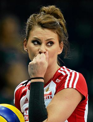 Polish volleyball star Katarzyna Skowronska looks on prior to the Volleyball European Championships match between Italy and Poland at the Hallenstadion in Zurich, Switzerland, Tuesday, Sept. 10, 2013. Italy won 3-0. (AP Photo/Keystone, Steffen Schmidt)