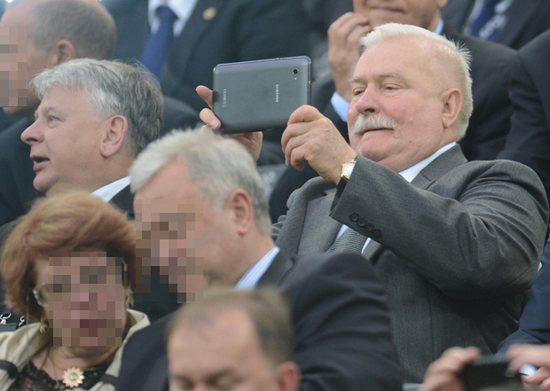 Polish former president Lech Walesa takes picture during the Euro 2012 football championships quarter-final match Germany vs Greece on June 22, 2012 at the Gdansk Arena.     AFPPHOTO/ PATRIK STOLLARZ