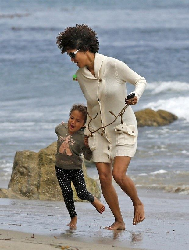 Halle Berry and daughter Nahla Aubry take a run and have some fun on the beach in Malibu, California.  Pictured: Halle Berry and Nahla Aubry
