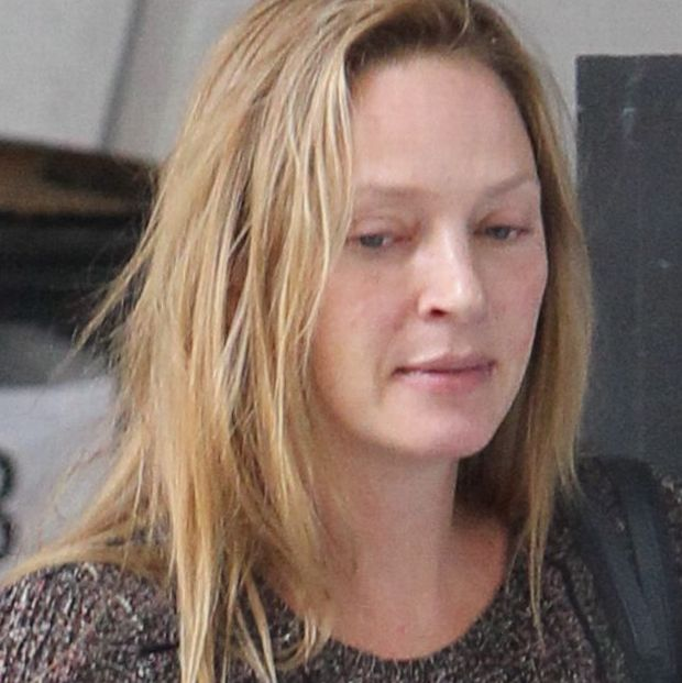 Uma Thurman was wearing no make up while leaving the doctor's office in NYC. The long-legged blonde was holding her 6 week-old daughter. August 30, 2012.  X17online.com  *** Local Caption ***  Uma Thurman