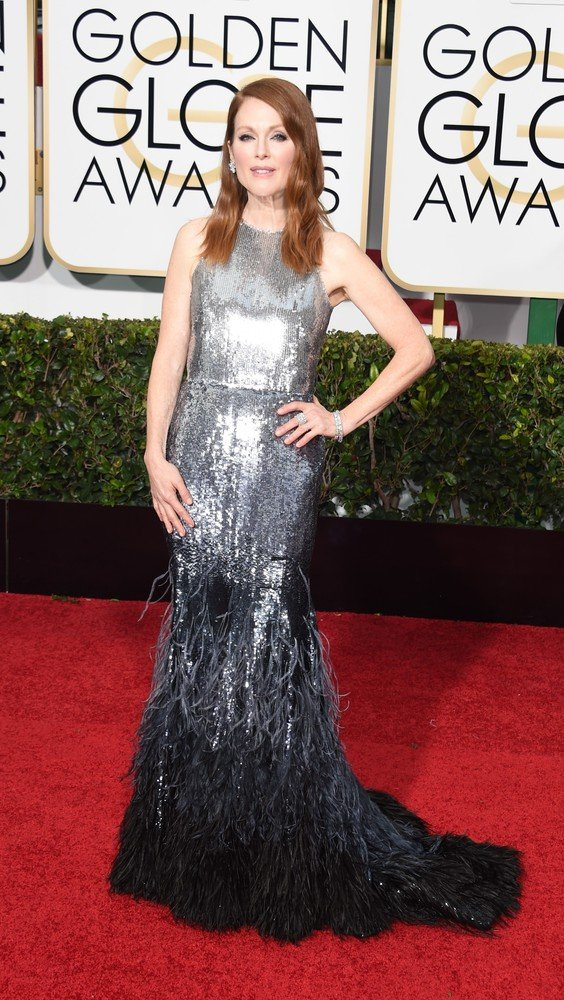 Actress Julianne Moore arrives on the red carpet for the 72nd Annual Golden Globe Awards, January 11, 2015 at the Beverly Hilton Hotel in Beverly Hills, California. AFP PHOTO / MARK RALSTON