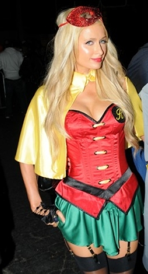 Paris Hilton attends Greystone Halloween party in West Hollywood, where the millionairess is spotted in her Robin suit joined by her reported boyfriend as Batman.   Pictured: Paris Hilton and River Viiperi