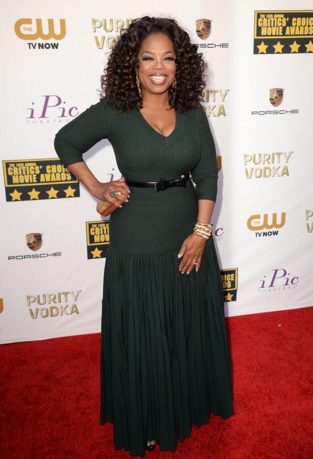 Oprah Winfrey arrives at the 19th annual Critics' Choice Movie Awards at the Barker Hangar on Thursday, Jan. 16, 2014, in Santa Monica, Calif. (Photo by Jordan Strauss/Invision/AP)
