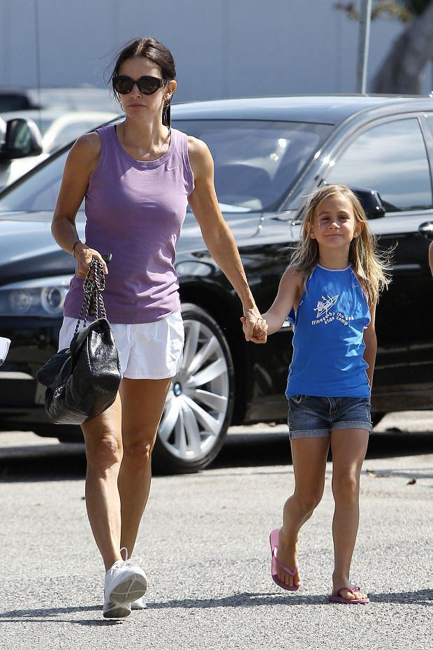 LOS ANGELES, CA - JULY 29: Courteney Cox and her daughter Coco Riley Arquette, hold hands as they walk into an office building on July 29, 2011 in Los Angeles, California. PHOTOGRAPH BY GSI / Barcroft Media UK Office, London. T +44 845 370 2233 W www.barcroftmedia.com USA Office, New York City. T +1 212 564 8159 W www.barcroftusa.com Indian Office, Delhi. T +91 11 4101 1726 W www.barcroftindia.com Australasian & Pacific Rim Office, Melbourne. E info@barcroftpacific.com T +613 9510 3188 or +613 9510 0688 W www.barcroftpacific.com