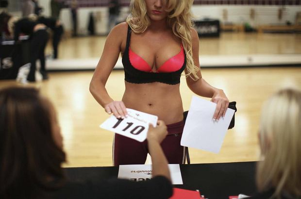 ATTENTION EDITORS - IMAGE 10 OF 40 OF PACKAGE 'RAVENS RULE THE SKIES'. SEARCH 'BALTIMORE RAVENS' FOR ALL IMAGES A participant checks-in during the first day of tryouts for the Baltimore Ravens cheerleaders in Baltimore, Maryland, March 5, 2011. Cheerleader talent is strong along the east coast and candidates drive to Baltimore for team tryouts each March hoping to join the squad. Hundreds of competitors face three intense days of sudden-death eliminations against returning team members expecting to make the squad.  Picture taken March 5, 2011.   REUTERS/Jason Reed  (UNITED STATES - Tags: SPORT)