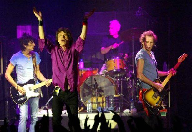 "Ron Wood, Mick Jagger, Charlie Watts and Keith Richards, from left to right, of the Rolling Stones perform on stage during a concert as part of the ""Licks World Tour"" in the Circus Krone in Munich, southern Germany, on Sunday, June 8, 2003.  (AP Photo/Jan Pitman, pool) ** NO SALES, EDITORIAL USE ONLY **"