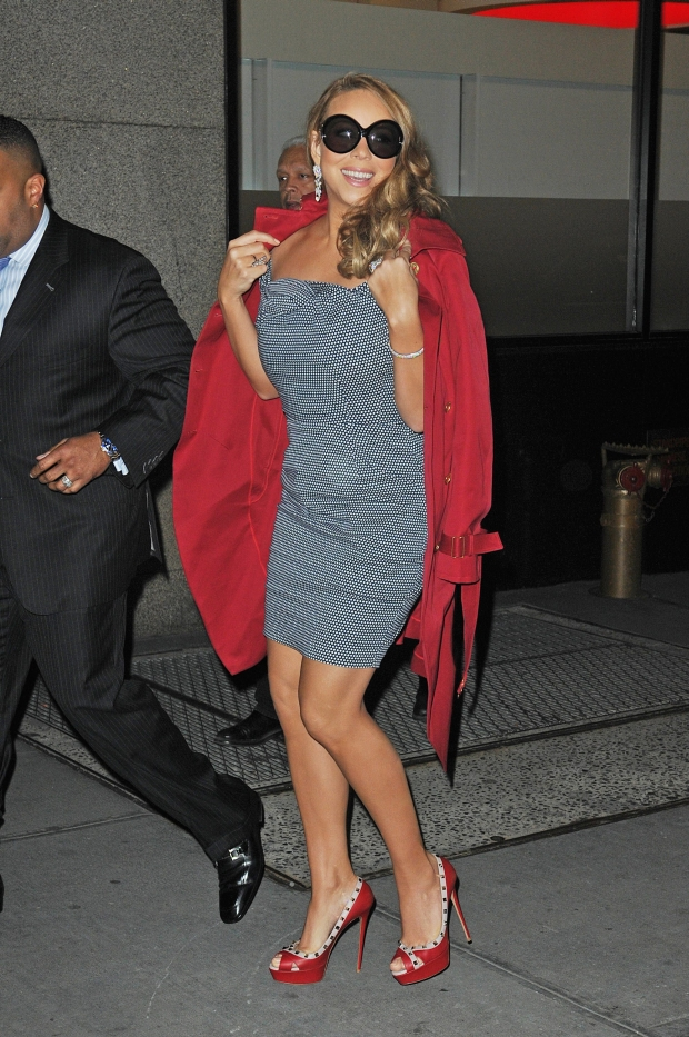 NEW YORK CITY - MARCH 01: EXCLUSIVE: Mariah Carey walks to her trailer to ready for free concert at Gothem hall. she half worn a red coat over a black and white polka dot dress on March 01, 2012 in New York City, New York.  (Photos by Josiah Kamau/BuzzFoto.com)    Buzz Foto LLC  .  .  .  .  .  . *** Local Caption *** Mariah Carey