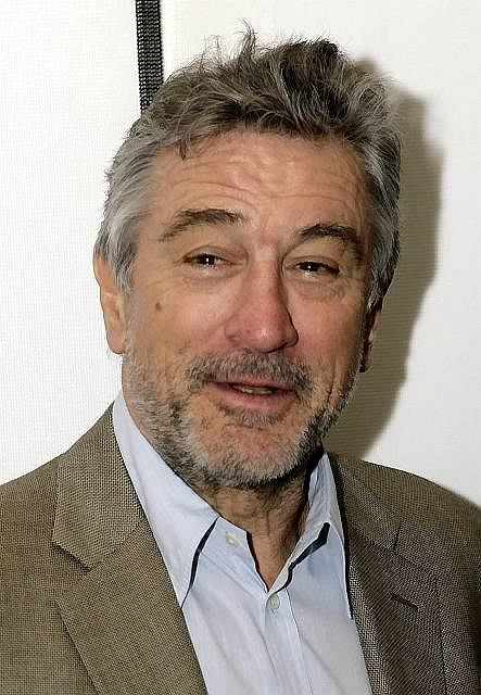 ** FILE ** In a file photo Robert DeNiro poses in New York, Sunday, April 22, 2007.   Traveling allowed  DeNiro to celebrate his birthday twice.  DeNiro first turned 64 Friday Aug. 17, 2007,  in Melbourne, Australia, where he attended the grand opening of his latest Nobu restaurant. Then he caught a private jet over the international date line and had another birthday Friday in Hawaii.   (AP Photo/Seth Wenig)