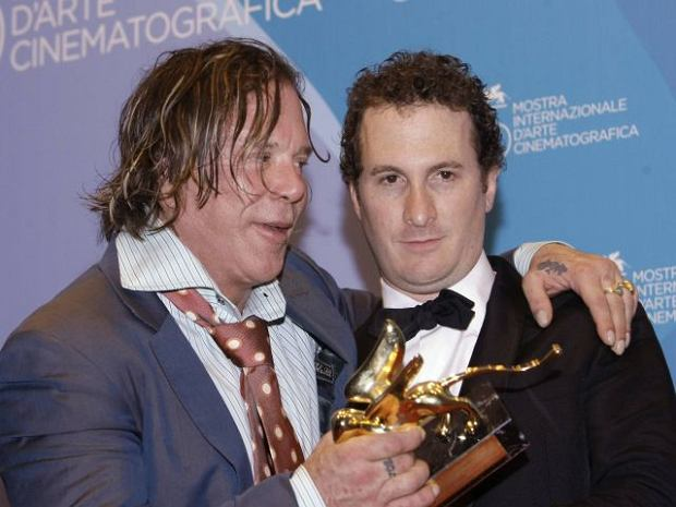 Actor Mickey Rourke holds the Golden Lion award for his film 'The Wrestler' with director Darren Aronofsky during the photo call at the 65th edition of the Venice Film Festival in Venice, Italy, Saturday, Sept. 6, 2008.  (AP Photo/Andrew Medichini)