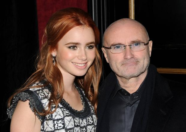"Actor Lily Collins, left and her father Phil Collins attend the Warner Bros. Pictures premiere of ""The Blind Side,"" in New York, Tuesday, Nov. 17, 2009. (AP Photo/Peter Kramer)"