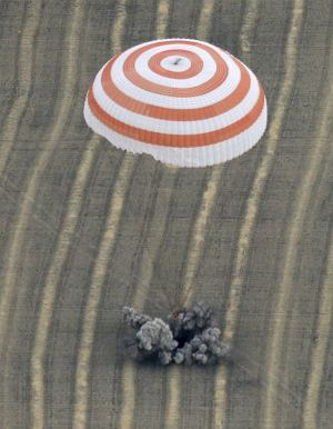 The Soyuz TMA-18 spacecraft is seen as it lands near the town of Arkalyk, northern Kazakhstan September 25, 2010. A Soyuz capsule carrying Russians Alexander Skvortsov and Mikhail Korniyenko, and NASA's Tracy Caldwell Dyson came back to Earth from the International Space Station and landed safely in Kazakhstan on Saturday, a day after an initial attempt to return was aborted after latches holding the Soyuz TMA-18 craft to the orbital station failed to open. REUTERS/Maxim Shipenkov/Pool (KAZAKHSTAN - Tags: SCI TECH POLITICS IMAGES OF THE DAY)
